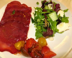 Bresola with pickled mixed tomatoes and strawberries